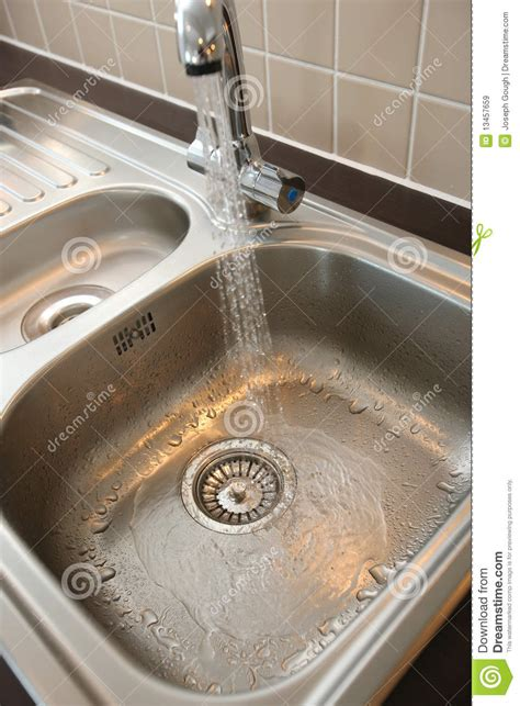 Kitchen Sink With Running Water Royalty Free Stock Images